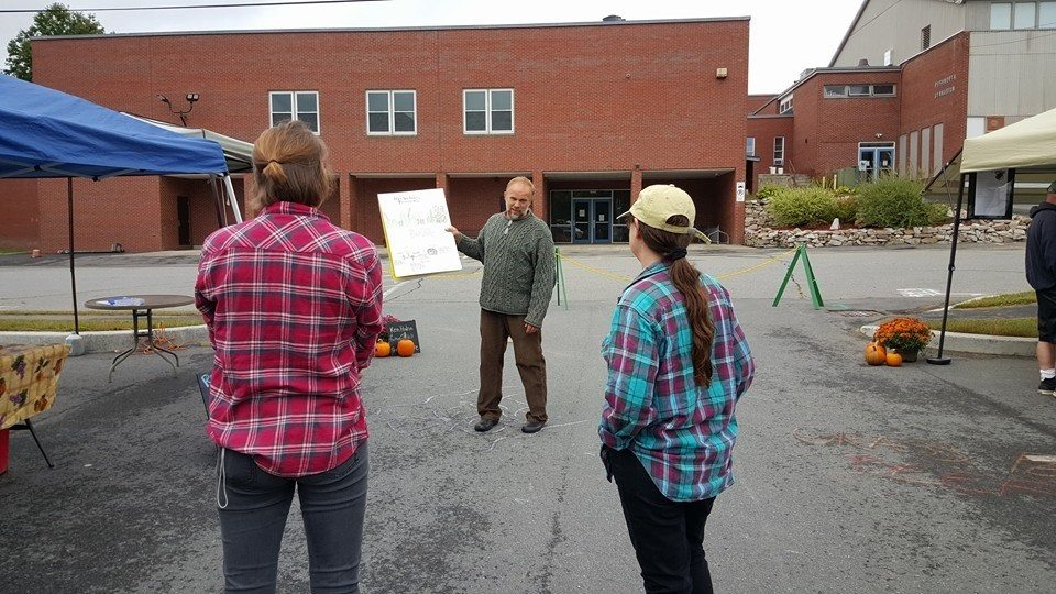 talking permaculture at farmers market